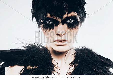 Portrait Of Serious Woman In Black Feather