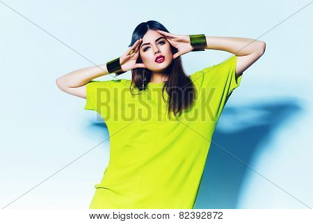 Cute Woman In Neon Green Dress On Blue Background