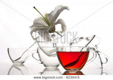6 Tea Cups And Flower