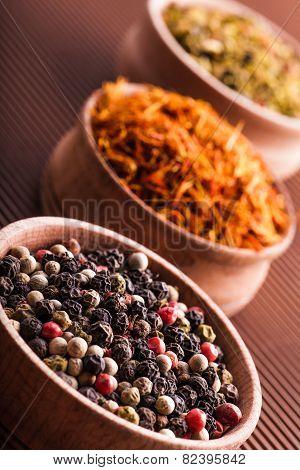 Pepper,saffron,paprika In A Wooden Bowl Close-up