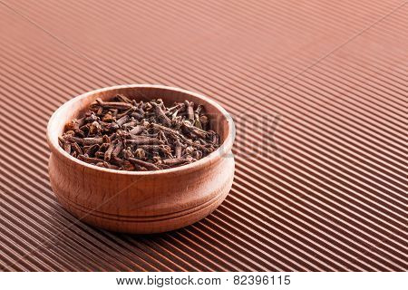 Clove In A Wooden Bowl Close-up