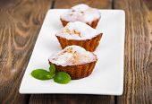 pic of bakeshop  - Homemade Muffins Ready for Breakfast in a plate on a wooden background