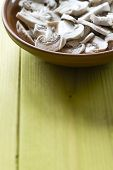 foto of champignons  - Whole Champignons in a Bowl on Wooden Boards closeup - JPG