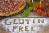 picture of immune  - A gluten free pizza on wood background - JPG
