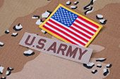 stock photo of camouflage  - US ARMY concept on desert camouflage uniform - JPG