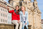 stock photo of stroll  - Friends at Dresden Frauenkirche strolling around as tourists - JPG