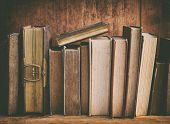 foto of hardcover book  - grunge bookshelf with old books - JPG