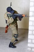 pic of ak 47  - insurgents with AK 47 inside the building - JPG