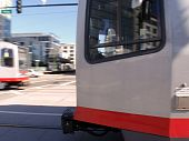 stock photo of chug  - Close view of San Francisco Light Rail trains racing in both directions - JPG