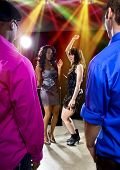 pic of bachelor party  - couple of guys trying to pickup women at a nightclub - JPG
