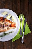 picture of pangasius  - Dish of Pangasius fillet with spices and vegetables on plate and wooden table background - JPG