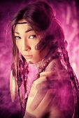 image of headdress  - American Indian in traditional costume and headdress of feathers - JPG