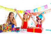picture of dog birthday  - girl friends party dancing with presents and puppy chihuahua dog in birthday - JPG