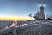 foto of marblehead  - The historic Marblehead Lighthouse in Northwest Ohio sits along the rocky shores of the frozen Lake Erie - JPG