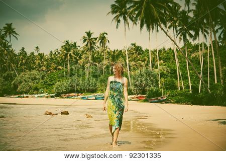 Woman walking on tropical beach - retro style photo