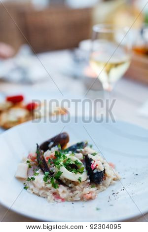 Close up of delicious seafood risotto served for lunch or dinner