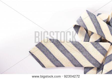 folded silk necktie isolated on white background
