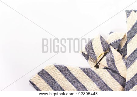 striped necktie with tie clip isolated on white.