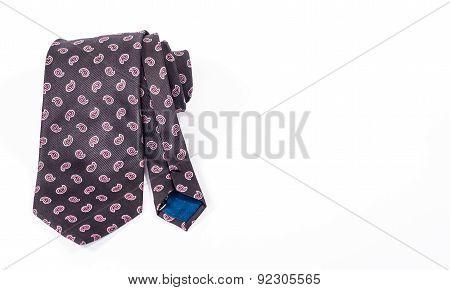 silk necktie roll isolated on white background