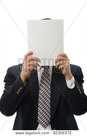 Businessman hiding behind blank poster isolated over white background