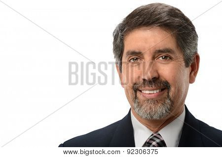 Mature Hispanic businessman smiling isolated over white background