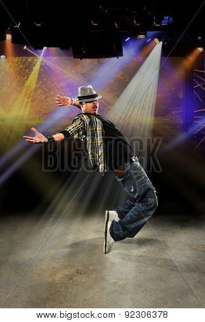 Young African American hip hop dancer performing on stage