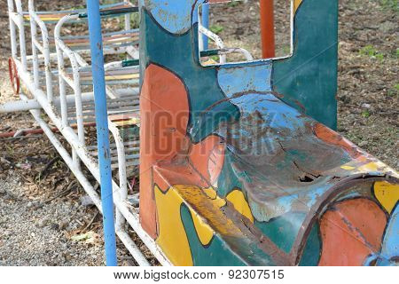 Old Metal Seat In Kid Playground