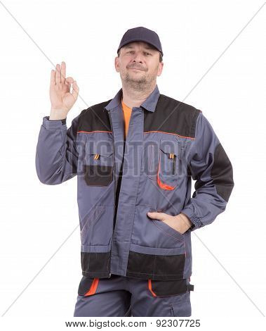 Working man smiling with ok sign.