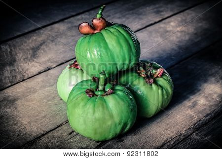 Still Life With Fresh Garcinia Cambogia On Wooden Background (thai Herb). Vignette