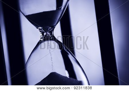 Hourglass In Blue Light.