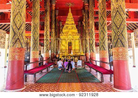 Tourists Pray The Buddha In Sanctuary