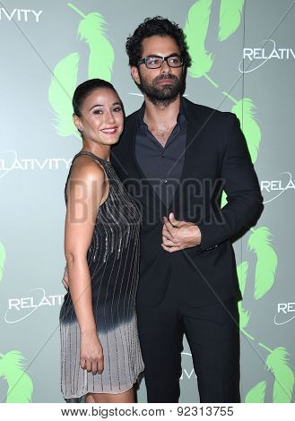 LOS ANGELES - MAY 09:  Emmanuelle Chriqui & Adrian Bellani arrives to the Aviva Family & Children's Services celebrates 100th Anniversary w/ The