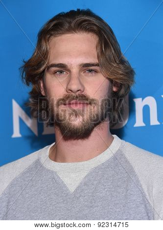 LOS ANGELES - APR 02:  Grey Damon arrives to the NBCUniversal's Summer Press Day 2015  on April 02, 2015 in Hollywood, CA