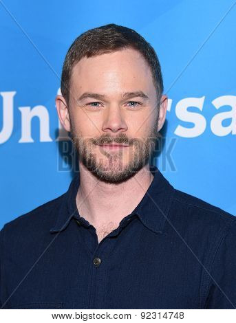 LOS ANGELES - APR 02:  Aaron Ashmore arrives to the NBCUniversal's Summer Press Day 2015  on April 02, 2015 in Hollywood, CA