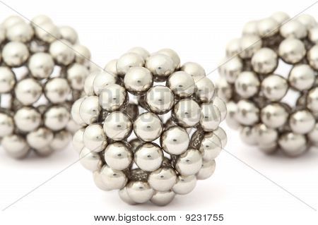 Three Balls Of Metal Segment Assembled From Neocube Isolated On White