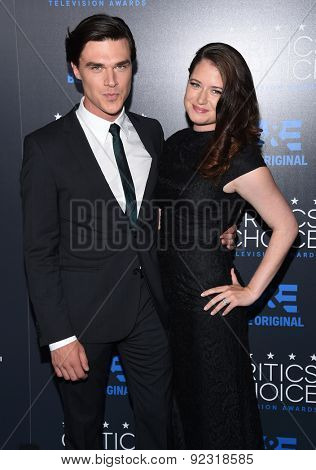 LOS ANGELES - MAY 31:  Finn Wittrock & Sarah Roberts arrives to the Critic's Choice Television Awards 2015  on May 31, 2015 in Hollywood, CA