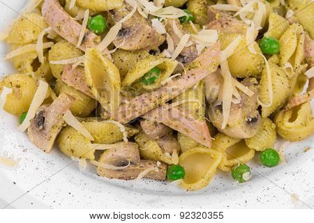 Italian pasta farfalle with mushrooms.