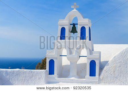 white with blue belfry, Santorini island, Greece