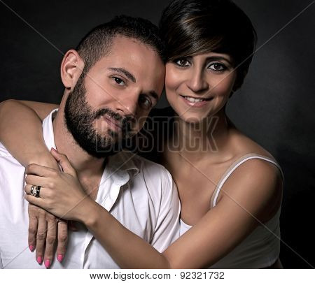 Portrait of beautiful gentle lovely couple over black background, romantic relationship, gentle feelings to each other, love and happy lifestyle concept