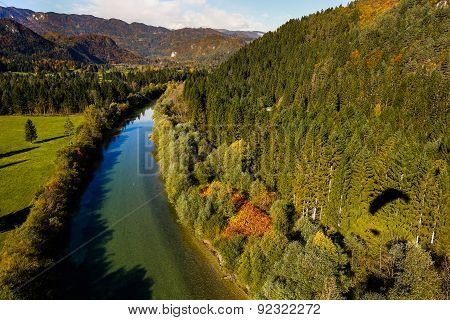 Turquoise River Flowing Through Forested Landscape