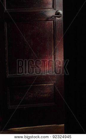 Beam Of Light On Half-open Door