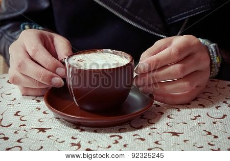 Hands Holding A Cup Of Caffe Mocha