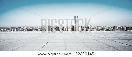 Empty floor and modern city skyline
