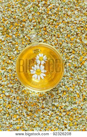 Camomile tea natural herbal organic beverage in glass transparent cup. Organic alternative relaxatio