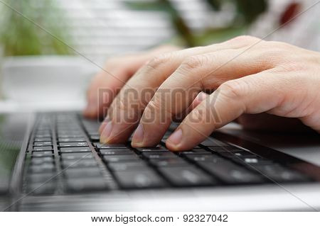 Closeup Of Male Fingers On Laptop Keyboard