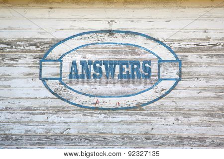 Answers text on barn wood side