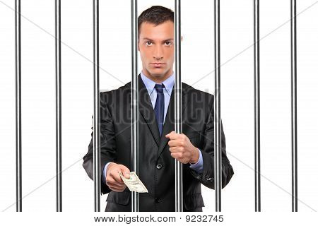 Businessman In Jail Giving Bribe
