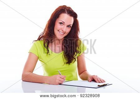 Business Young Woman Writes On The Folder On The Table