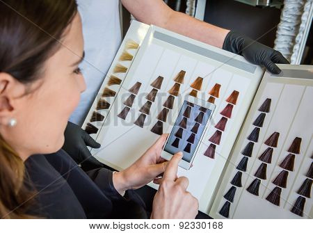 Woman taking a photo to the hair dye palette