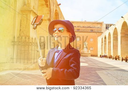 little boy taking selfie picture while travel in Europe
